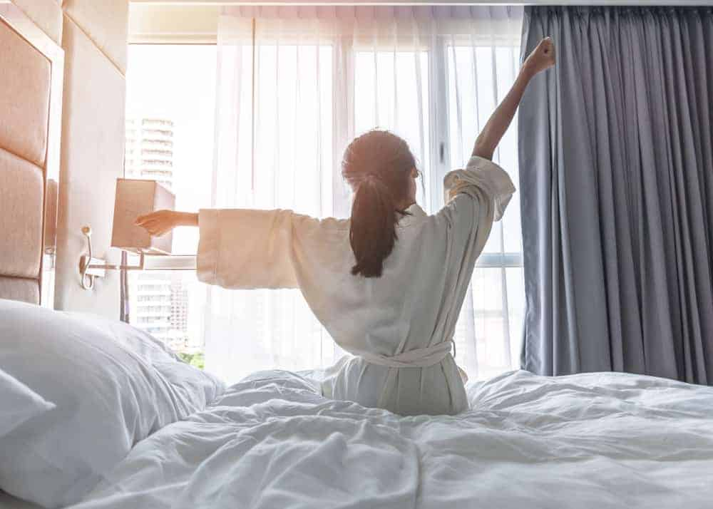 Quality sleep starts with quality bed sets women waking up fresh
