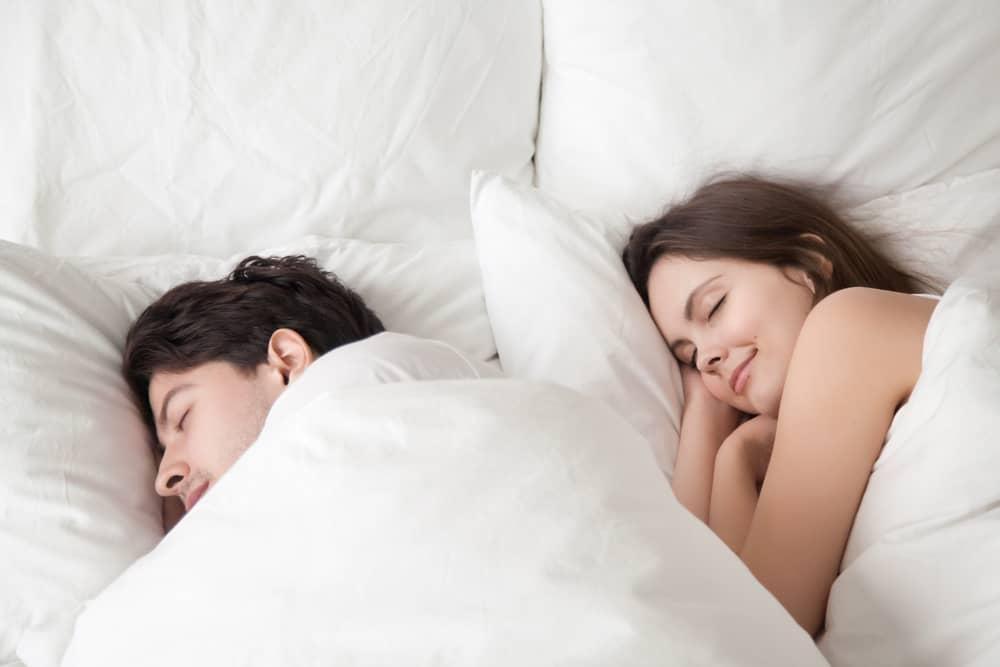Couple sleeping comfortable on Genie beds