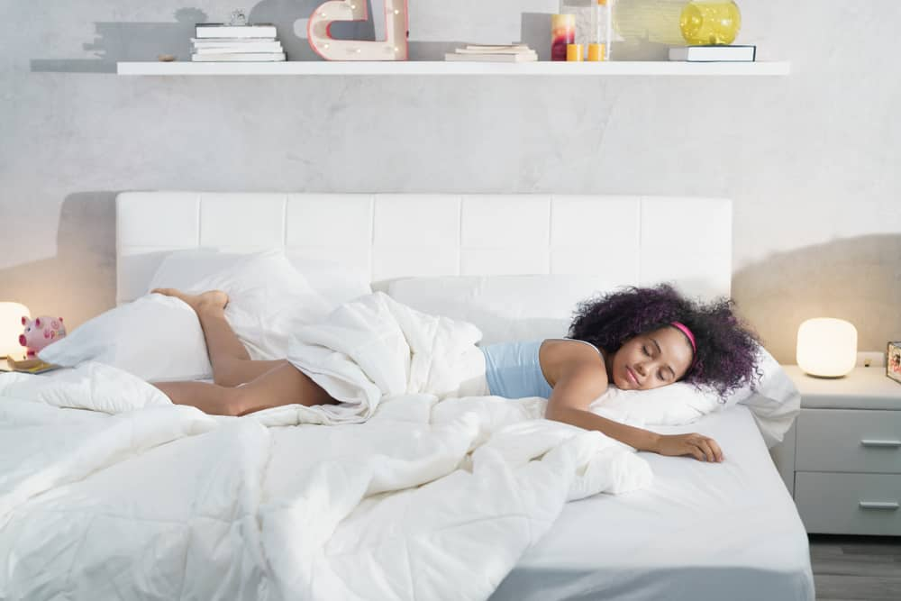 Lady sleeping comfortably on king bed